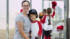 Portrait of mom and daughter in little league Stock Footage