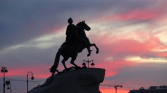 Colourful pink and gray clouds sunset over Bronze Horseman monument, time lapse Stock Footage
