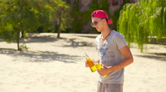 Handsome smilling man brings beer for friends Stock Footage