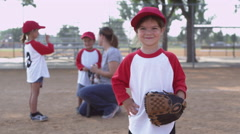 Portrait of little girl in little league Stock Footage