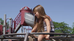 Little girl playing on the jungle gym Stock Footage