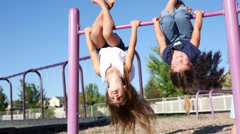Little girls playing on jungle gym Stock Footage