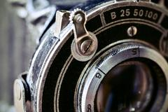 Lens of an old folding camera Stock Photos