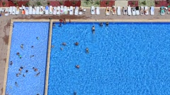 People swim in the swimming pool at the hotel. Top view. Turkey Stock Footage