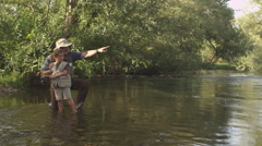 Father teaching son how to fish Stock Footage
