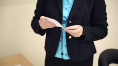 Girl secretary inserts business cards to badges Stock Footage