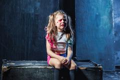 The crying crasy girl on dark background Stock Photos