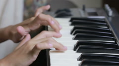 Woman teaching little girl to play the piano. musical instruments Stock Footage