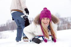 Sledding woman Stock Photos