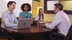 Coworkers having a meeting in a conference room Stock Footage