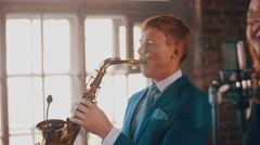 Saxophonist in blue suit play on golden saxophone. Live performance. Jazz Stock Footage