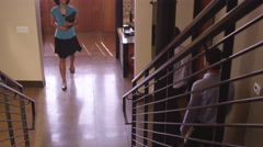 Office workers walking up staircase Stock Footage