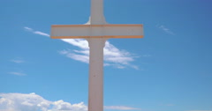 Tilt to Reveal an Isolated White Cross - 4K Stock Footage