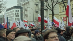 People waiting for march to start. A lot of banners and flag in the air. Stock Footage