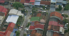 Buildings and railway with a passing train in city of Kuala Lumpur, Malaysia Stock Footage