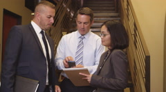 Portrait of three office workers near staircase Stock Footage