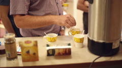 Stir the sugar in the coffee cup Stock Footage