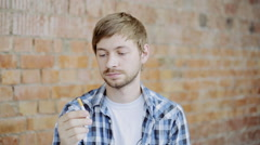 Portrait of man trying to quit smoking. Stop smoking Stock Footage