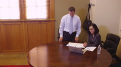 Two office workers meeting with businessman Stock Footage