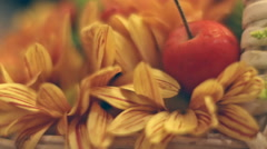 Close up Flower Arrangement, floral bunch with red apple in basket  Stock Footage