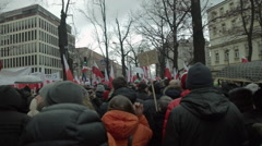 Demonstration to Defend Democracy in Warsaw. March on the move. Polish flags. Stock Footage