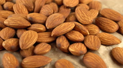 Almond rotating on parchment. Seamless loopable. Prores 4K Stock Footage