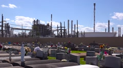A cemetery or graveyard in Louisiana exists adjacent to a huge petrochemical Stock Footage