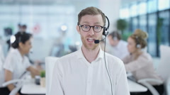 4K Friendly customer service adviser talking to a customer via video call Arkistovideo