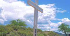 Wide Tilt to Reveal a White Cross - 4K Stock Footage