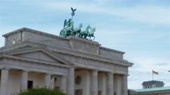 Real Time Medium shot of the Brandenburg Gate in Berlin and waving German flag. Stock Footage
