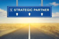 Strategic partner words on blue road sign Stock Photos