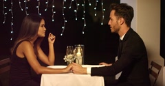 Romantic couple enjoying an evening dinner Stock Footage