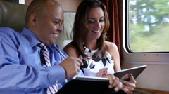 Business travelers on train Stock Footage