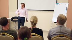 A business coach leads a workshop Stock Footage