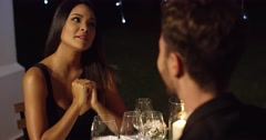 Elegant young woman enjoying a dinner date Stock Footage