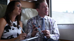 Business travelers using tablet Stock Footage