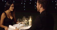 Surprised woman looks questioningly at husband Stock Footage