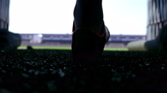 Silhouette of a football player going out to the stadium Stock Footage