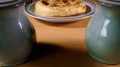Forward slide shot of a buttered crumpet. Stock Footage
