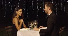 Couple smiles across restaurant dinner table Stock Footage