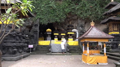 4k Indonesia holy bat temple cave entry Goa Lawah Bali with ritual priest Stock Footage