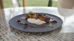 Grilled turkey spins on dish with potato, herbs, nuts and redish served with Stock Footage