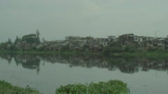 View of slum area near lake Stock Footage