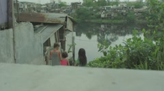 Children standing in slum area Stock Footage