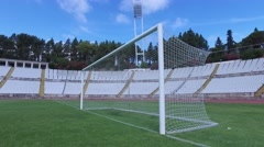 Goal net stadium soccer football field turf steady shot gimbal 4k Stock Footage