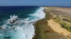 Waves breaking up on rocky coastline of Klein Curacao Stock Footage
