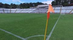 Flag corner stadium soccer football field turf steady shot gimbal 4k Stock Footage