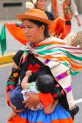 Local woman with a baby walking during Festival of the Virgin de la Candelari Stock Photos