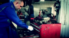 Male maintenance engineer arranging tools in drawer at car workshop Stock Footage