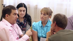 People communicate at the workshop Stock Footage